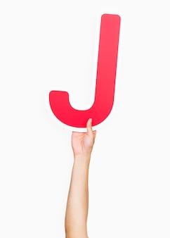 Mains tenant la lettre j