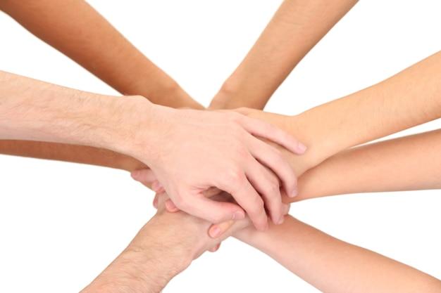 Mains unies isolées sur blanc