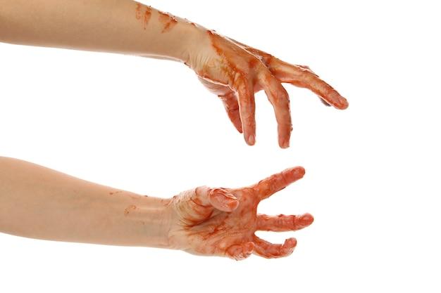 Mains de zombies de sang isolés sur blanc
