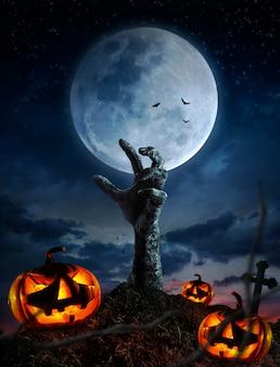 Mains zombies se levant dans la nuit sombre halloween.