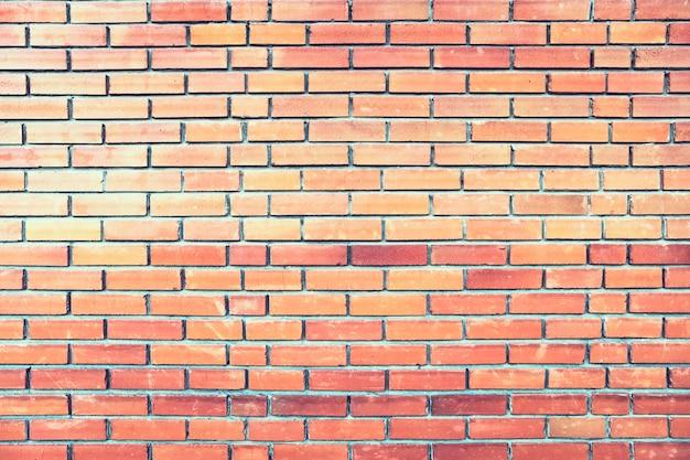 Une maison en brique. maçonnerie couleur orange. mur de briques. fond.