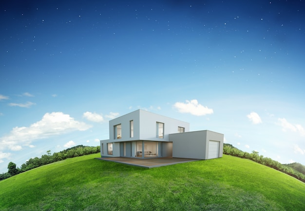 Maison moderne sur la terre et l'herbe verte avec fond de ciel bleu.