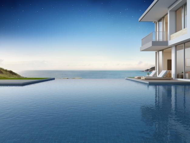 Maison de plage de luxe avec piscine vue mer et terrasse au design moderne.