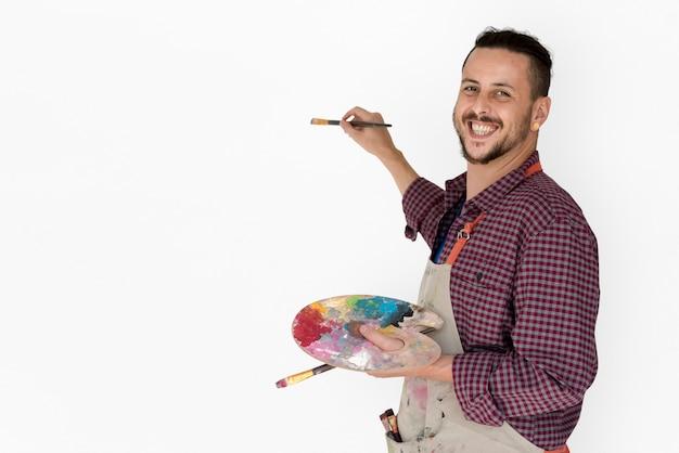 Man brush drawing palette de couleurs arts studio portrait