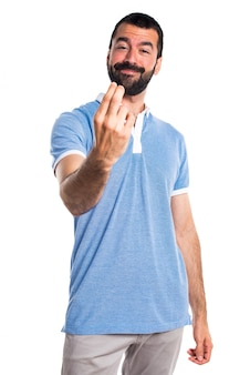Man with blue shirt coming gesture