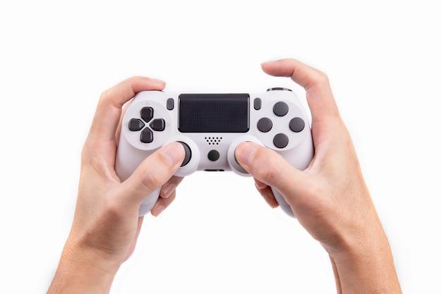 Manette de jeu joystick en main isolé sur fond blanc