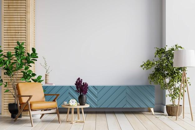 Maquette d'armoire dans un salon moderne avec fauteuil en cuir et plante sur fond de mur blanc, rendu 3d
