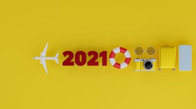 Maquette avec avion, anneaux de natation gonflables, appareil photo, bagages et lunettes de soleil