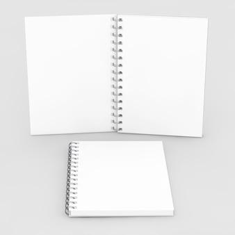 Maquette de bloc-notes en spirale vierge sur fond blanc. rendu 3d