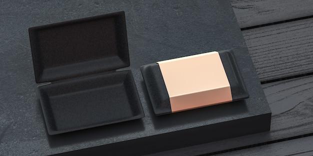 Maquette de boîte noire avec couverture dorée pour la marque et l'identité