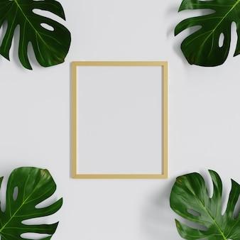 Maquette de cadre avec des feuilles de monstera