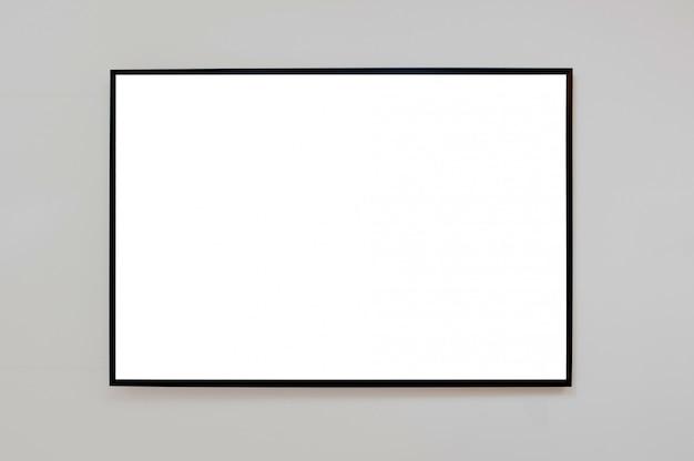 Maquette cadre noir pour photo, publicité ou affiche sur un mur gris
