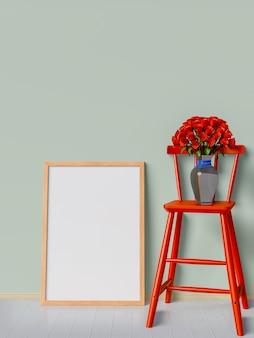 Maquette cadre et roses rouges sur une chaise rouge.