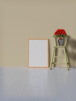 Maquette cadre et roses rouges sur la chaise.