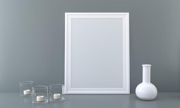 Maquette de cadre vertical avec pot en verre à bougie et vase
