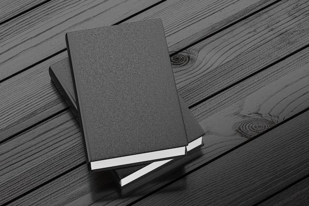 Maquette de carnet noir sur table en bois foncé