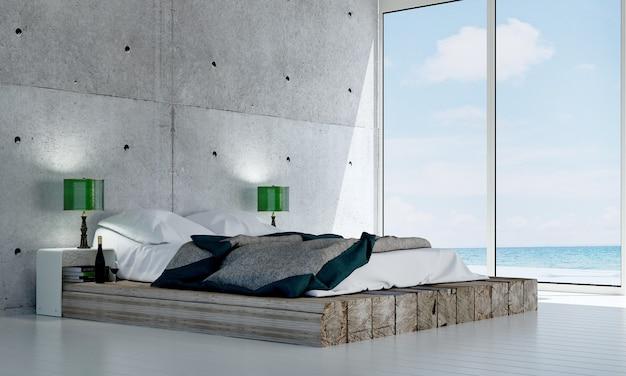 Maquette de décor de meubles dans un intérieur de chambre de style loft moderne et fond de vue sur la mer rendu 3d