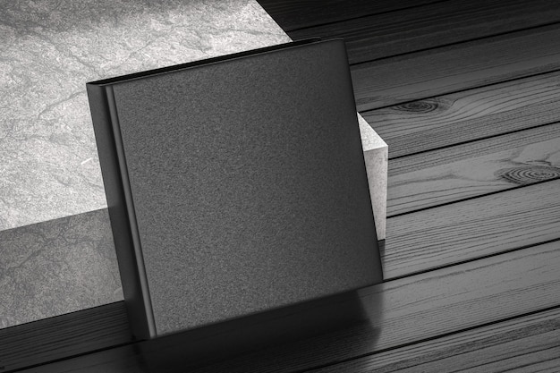 Maquette de livres blancs carrés noirs avec couverture rigide texturée sur plancher de bois près d'escalier en béton