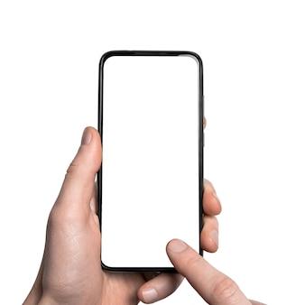 Maquette, maquette main de l'homme tenant le smartphone noir avec cadre moins écran blanc et design sans cadre moderne, vertical - isolé sur blanc chemin de détourage interface de conception d'interface utilisateur.