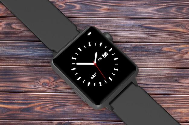 Maquette de montre intelligente moderne noire avec sangle sur une table en bois. rendu 3d