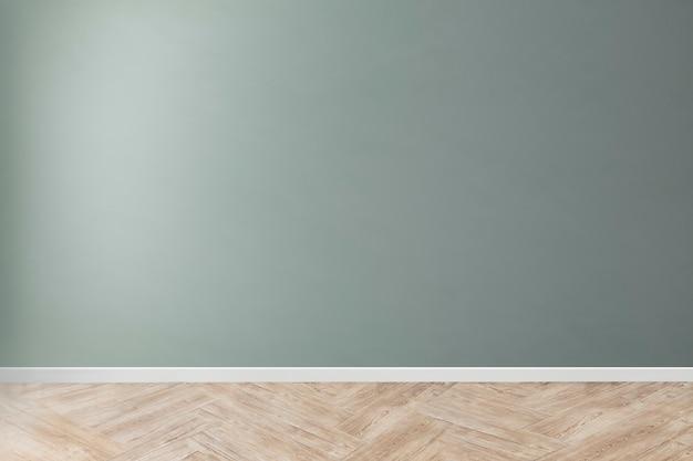 Maquette de mur de béton vierge verte avec un plancher en bois