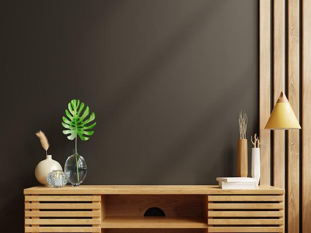 Maquette de mur sombre avec des plantes ornementales et un élément de décoration sur une armoire en bois. rendu 3d