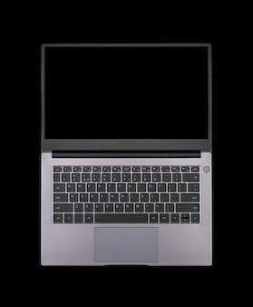 Maquette noire sur un écran d'ordinateur portable ouvert isolé sur une vue de dessus de fond noir