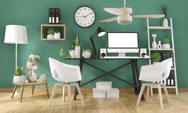 Maquette ordinateur avec écran blanc et décoration dans la pièce verte du bureau maquette rendu en arrière-plan 3d