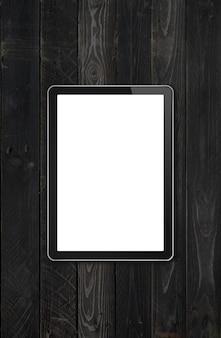 Maquette d'ordinateur pc tablette vierge moderne sur un bureau en bois noir