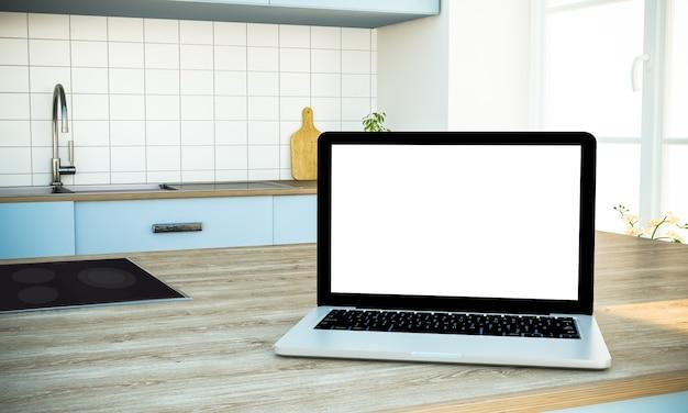 Maquette d'ordinateur portable à écran blanc sur un îlot de cuisine à la cuisine