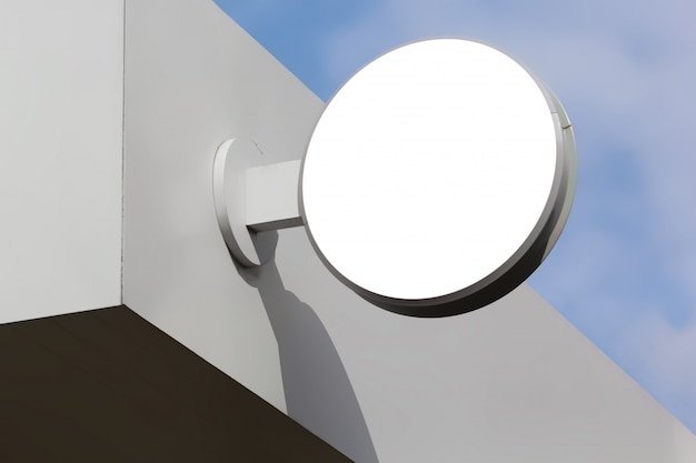 Maquette de panneau de signalisation rond blanc sur mur blanc