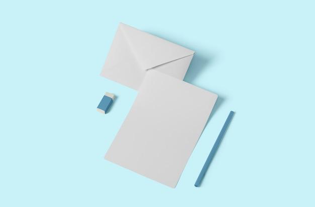Maquette de papeterie vide blanche, ajoutez votre design. concept simple de retour à l'école isolé sur bleu doux.