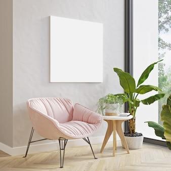 Maquette photo sur un mur clair au-dessus d'un fauteuil rose moderne et d'une plante