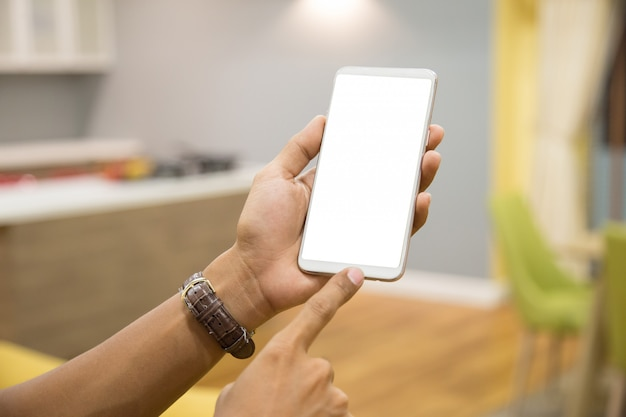 Maquette smartphone sur les mains de l'homme d'affaires.