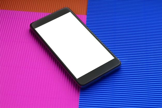 Maquette smartphone vue de dessus sur fond multicolore branché.