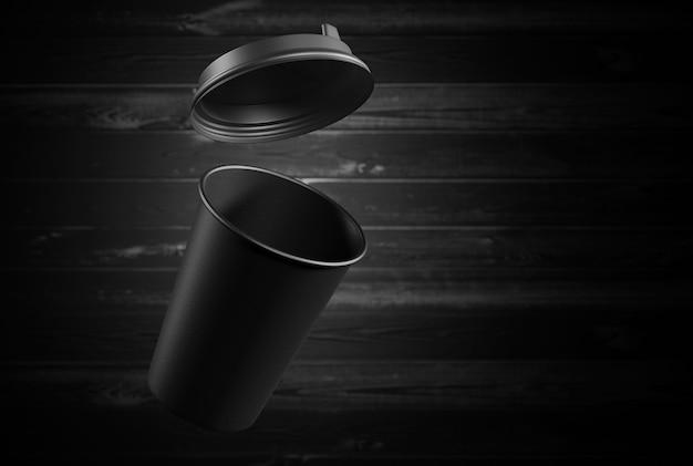 Maquette d'une tasse en papier noir sur un fond en bois. rendu 3d