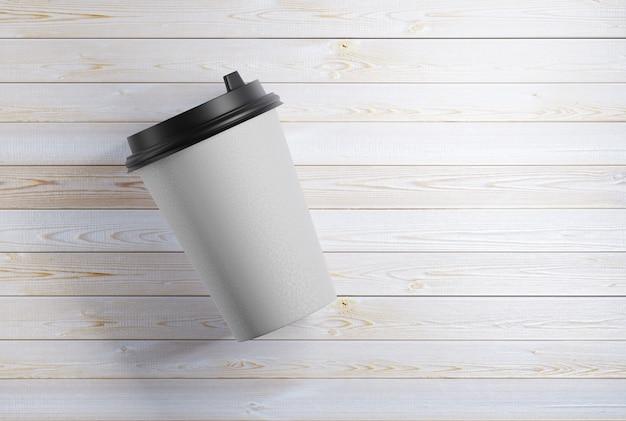 Maquette d'une tasse en papier posée sur une table en bois. rendu 3d