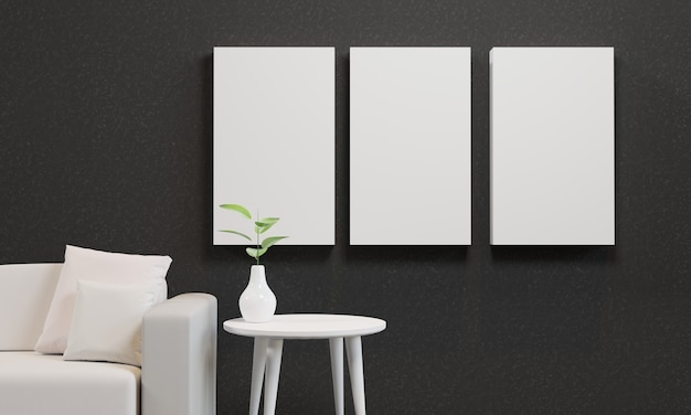 Maquette de trois cadres sur un mur noir avec un canapé blanc et une plante sur une table