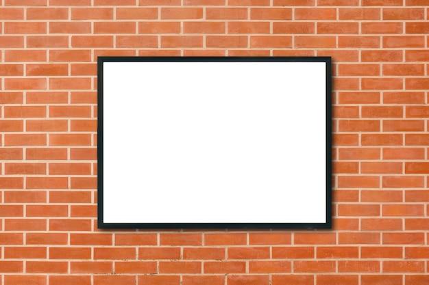 Maquette vierge cadre photo affiche suspendue sur fond de mur de brique rouge dans la chambre