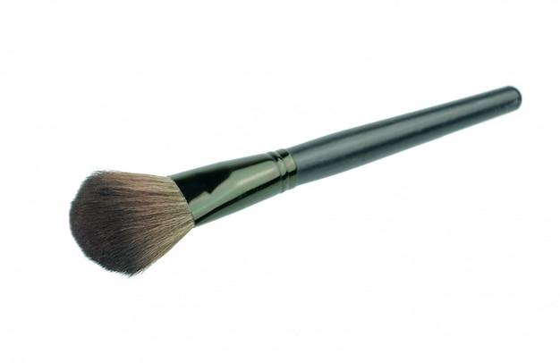 Maquillage pinceau isolé sur fond blanc