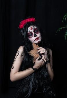 Maquillage sur le thème jour des morts mexicain