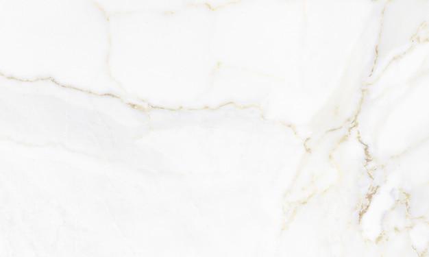 Marbre calacatta avec fond de texture de veines dorées