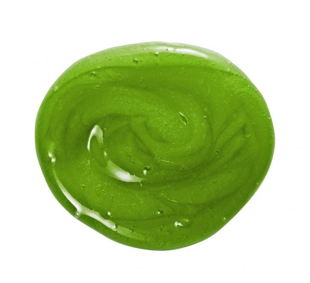Masque capillaire, revitalisant, shampooing texture crémeuse. goutte d'échantillon de cercle de crème cosmétique vert naturel isolé