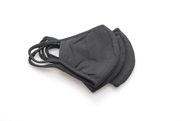 Masque en tissu noir pour protéger covid 19 sur fond blanc isolé