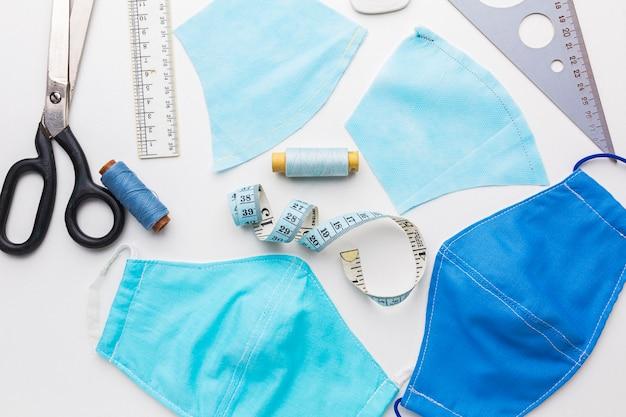 Masques médicaux avec fil et ruban à mesurer