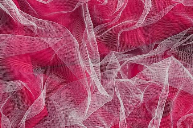Matériau de tissu de décoration à l'intérieur rouge et transparent