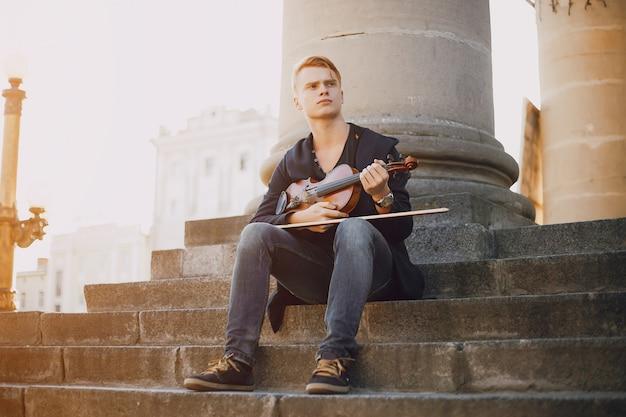 Mec avec du violon