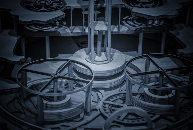 Mécanisme d'horloge réalisé dans la technique de tonification. profondeur de terrain très peu profonde. focus sur les engrenages centraux