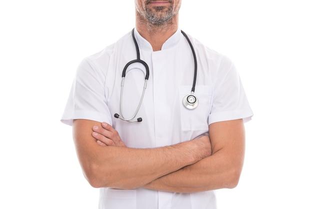 Un médecin avec un outil de médecine stéthoscope isolé sur blanc fait la réception des patients pendant la pandémie de coronavirus, aide et soutien.