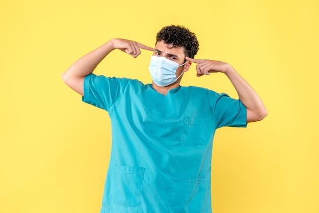 Médecin de la vue de face le médecin en masque pense aux patients atteints de coronavirus
